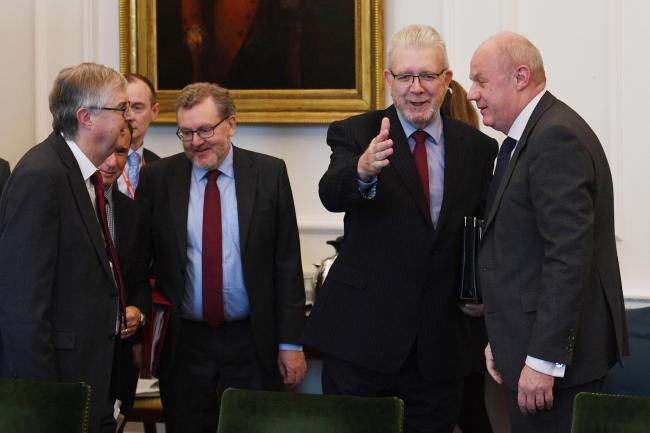 Scotland's Brexit Minister Michael Russell (second right) is greeted by First Secretary of State Damian Green (right) as they arrive for a Joint Ministerial Council on Brexit in the Cabinet Office, London. Photograph: Stefan Rousseau/PA Wire.