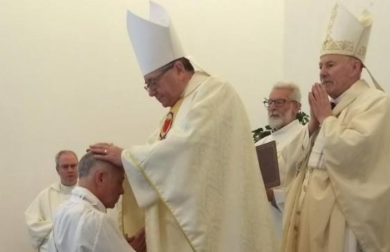 Ordination 1 – Fr Simon Beveridge receiving the Laying on of Hands from Monsignor Keith Newton with Bishop William Nolan, Bishop of Galloway, the ordaining Bishop, behind.