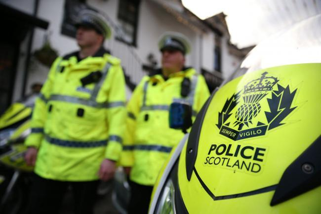 Police seize cash and drugs at Elgin house after stopping