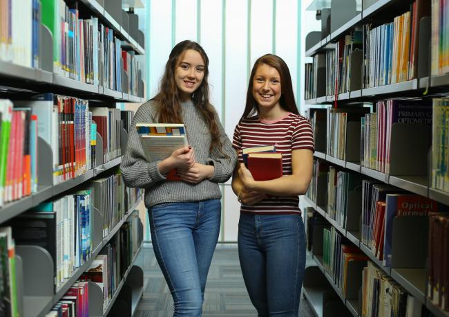 Leah Wright, left, and Abbie Fenton both age 17 pictured in the library at Glasgow Caledonian University (GCU) where they are studying Advanced Highers. Picture: Colin Mearns