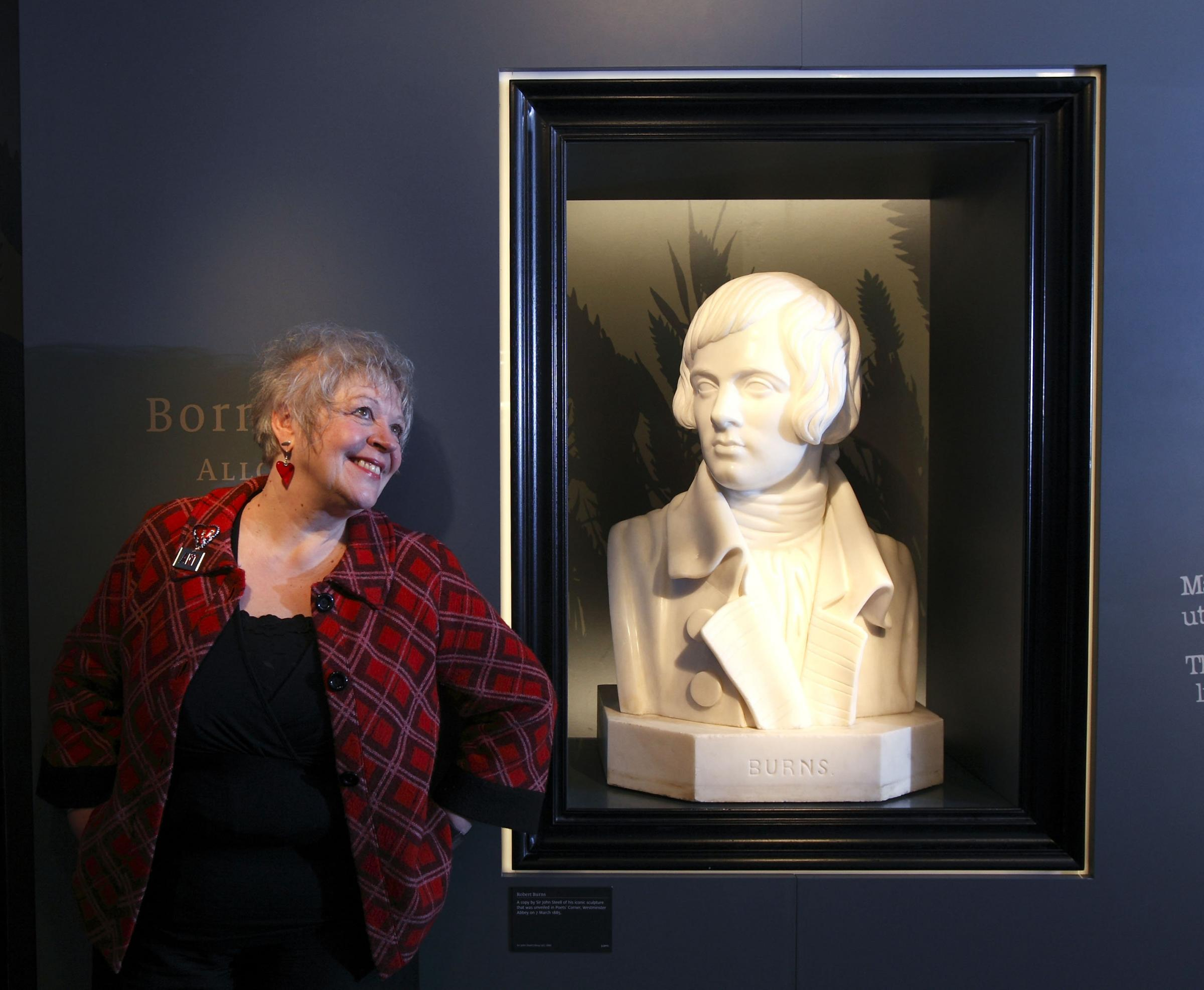 Liz Lochhead pictured next to a bust of Burns in the Robert Burns Birthplace Museum in Alloway