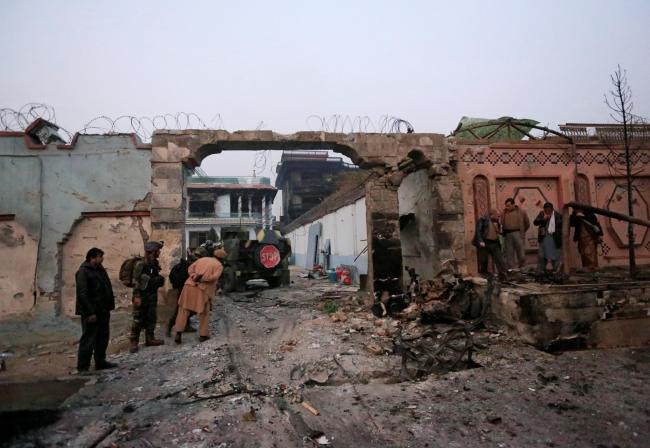 The entrance gate to the Save the Children Aid compound in Jalalabad is wrecked after IS terrorist set off a car bomb and opened fire on staff there.