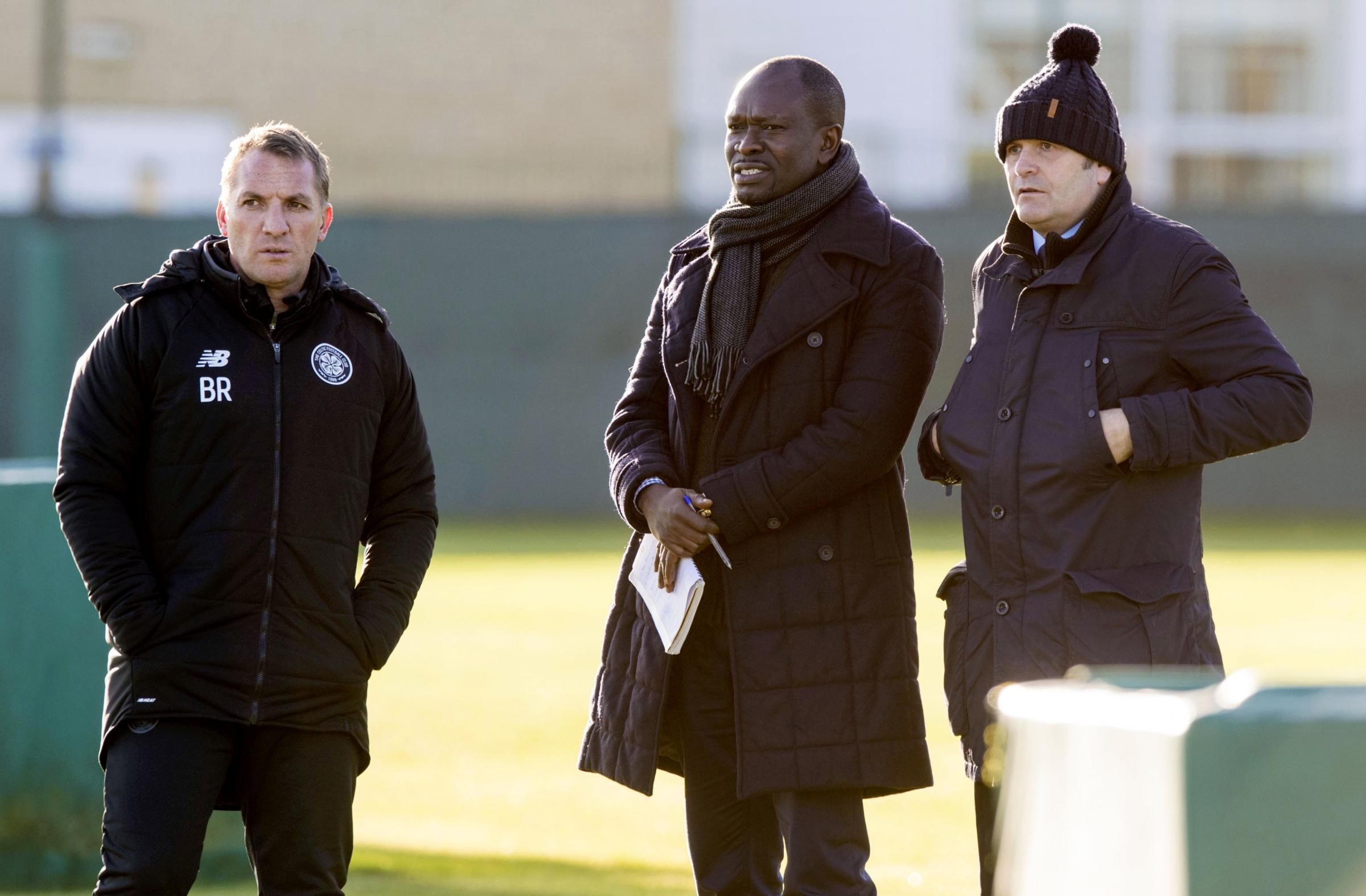 Celtic manager Brendan Rodgers, left, watches training with Allan Preston, right.