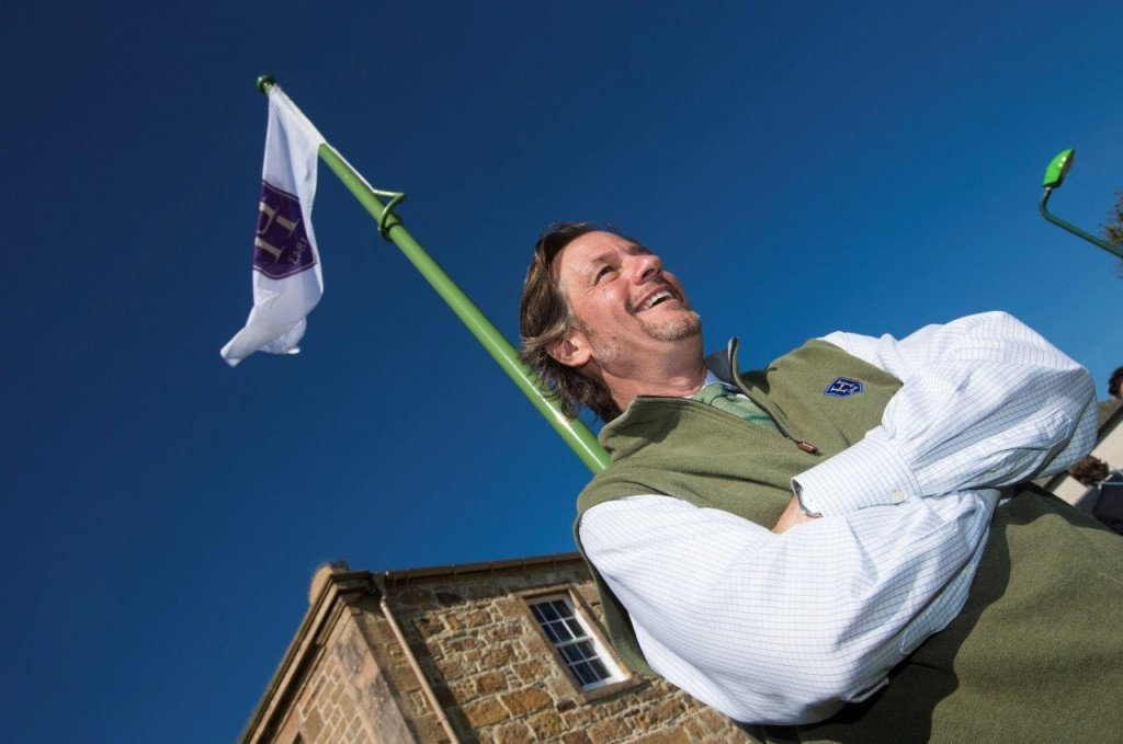 TODD WARNOCK RAISES THE FLAG TO MARK THE OPENING OF LINKS HOUSE AT ROYAL DORNOCH