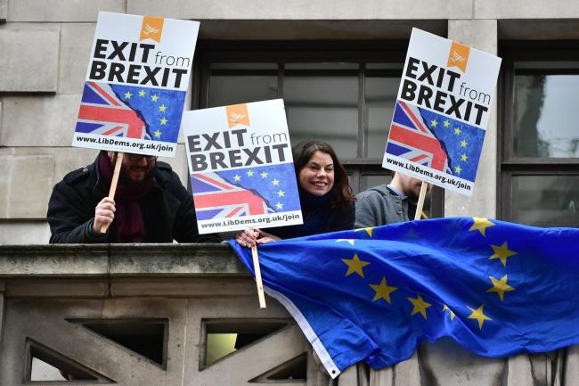 Former Liberal Democrats MP Sarah Olney (centre) joins Remain protesters ahead of a speech by Foreign Secretary Boris Johnson on Brexit. Photograph: Dominic Lipinski/PA Wire.