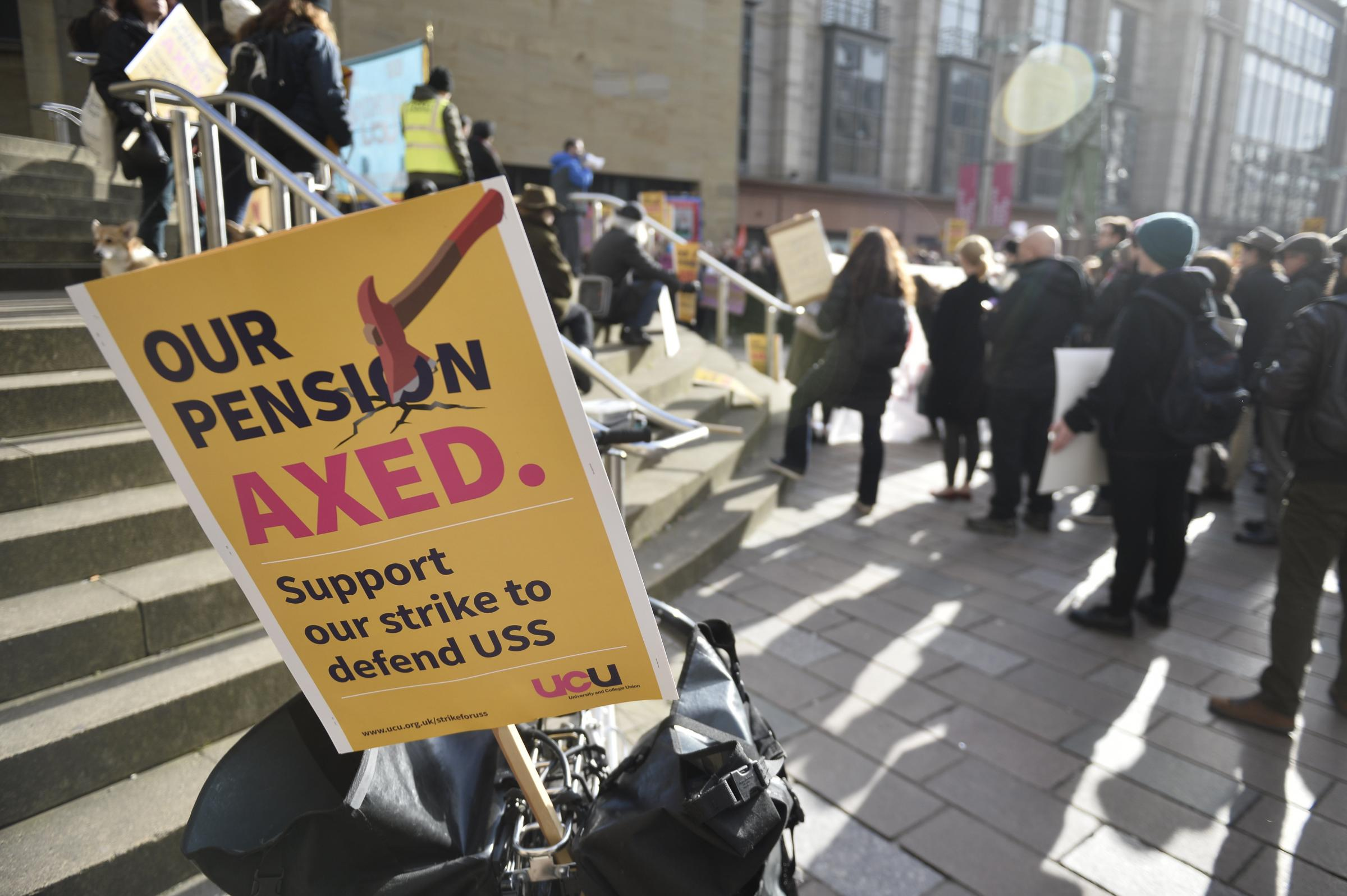 Academics from Strathclyde and Glasgow Universities hold a rally as part of a walk-out over proposed reforms to their pensions.
