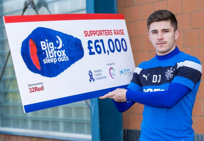 Declan John with a cheque for £61,000 raised by Rangers supporters at the Big Ibrox Sleepover.