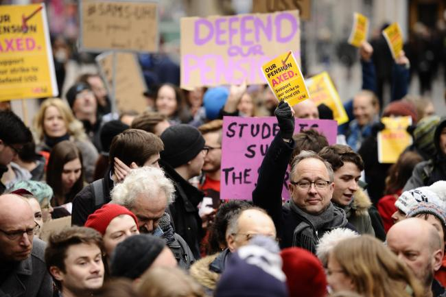 GLASGOW, SCOTLAND - FEBRUARY 22: a general view of Members of the University and College Union (UCU) from the University of Glasgow and Strathclyde University taking part in a walkout on Buchanan Street on February 22, 2018 in Glasgow, Scotland. The strik
