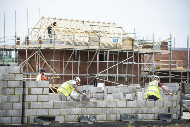 Builders work on a housing development