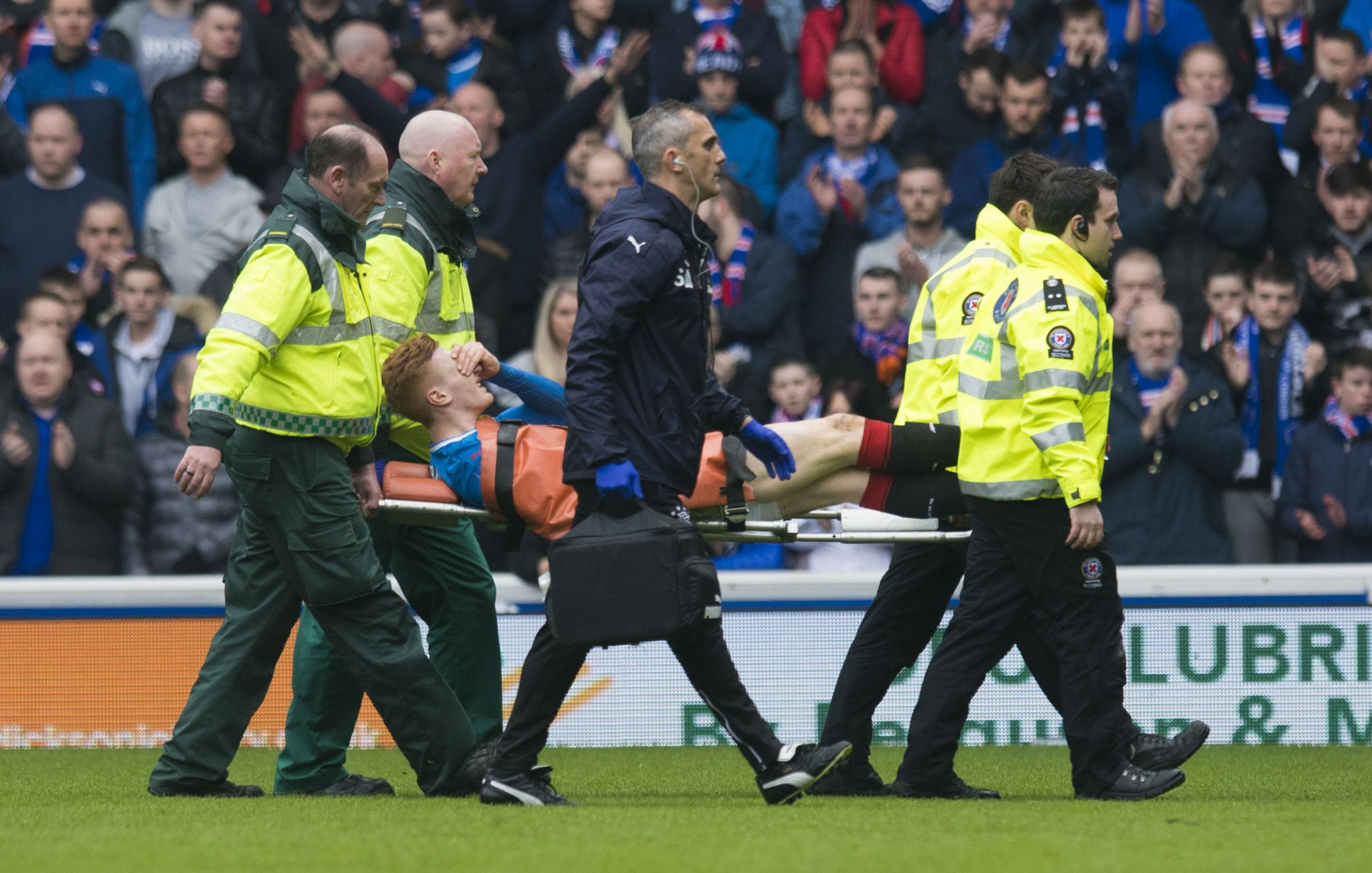 David Bates is stretchered off
