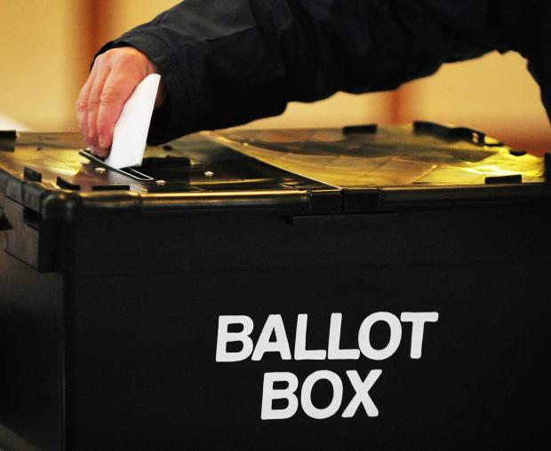 HeraldScotland: Voting maybe private but information exchange beforehand is not File photo dated 06/05/10 of a voter placing a ballot paper in the ballot box at a polling station, as each general election could become a nation holiday that has been endorsed by MPs as par