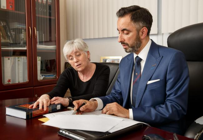 Clara Ponsati and her lawyer Aamer Anwar in his Glasgow office.