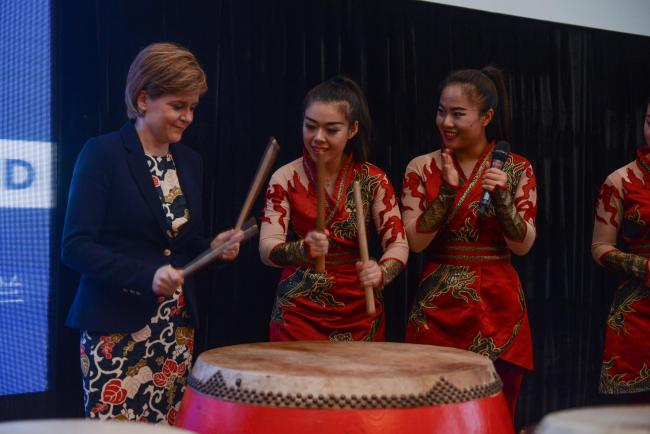 First Minister Nicola Sturgeon has a go on the drums with the Beijing Red Poppy Ladies Percussion Group at a Scotland reception to showcase the best of Scottish food, drink and culture in 2015.