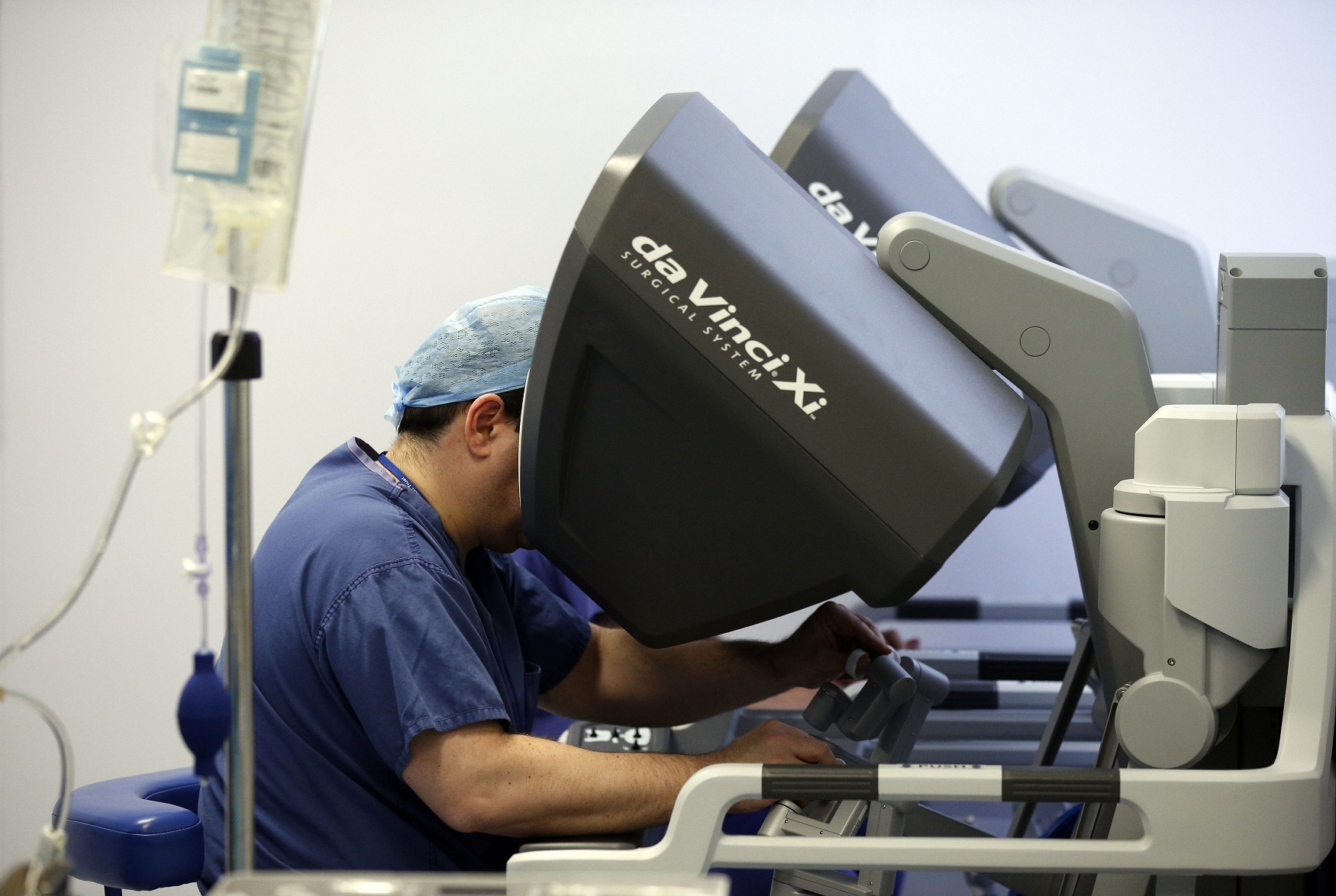 File photo dated 29/1/2015 of surgeons using the da Vinci Xi surgical system carry out a colorectal surgery at the Royal Marsden in London. A cancer patient is recovering at home after being operated on in two areas at the same time in a rare procedure us