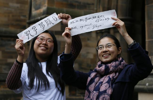 Volunteer teachers from China celebrate in Glasgow, in 2014, the 10th anniversary of the Confucius Insititutes.Picture: Colin Mearns.