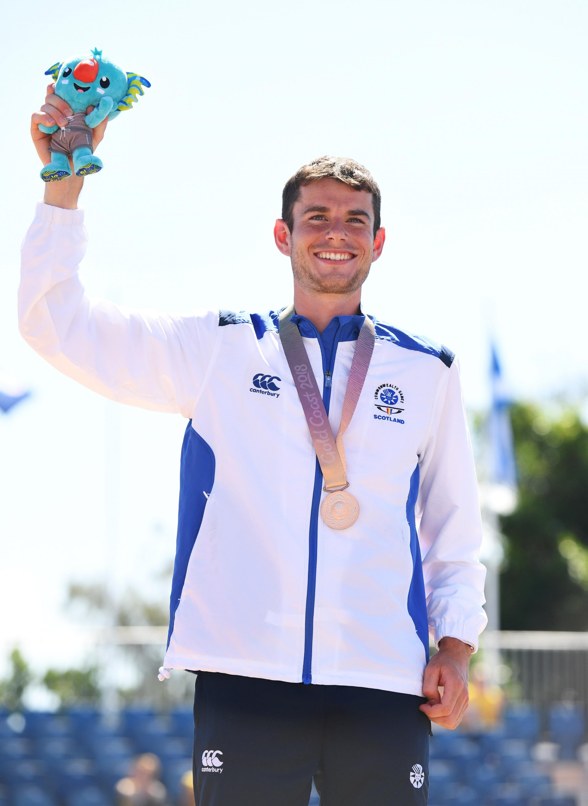 GOLD COAST, AUSTRALIA - APRIL 15:  Bronze medalist Robbie Simpson of Scotland celebrates during the medal ceremony for the MenÂs marathon  on day 11 of the Gold Coast 2018 Commonwealth Games at Southport Broadwater Parklands on April 15, 2018 on the Gold