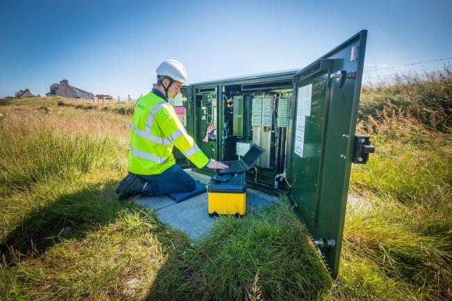 An engineer from BT works at a fibre broadband cabinet on the Western Isles, which came bottom of the Which? mobile coverage survey.