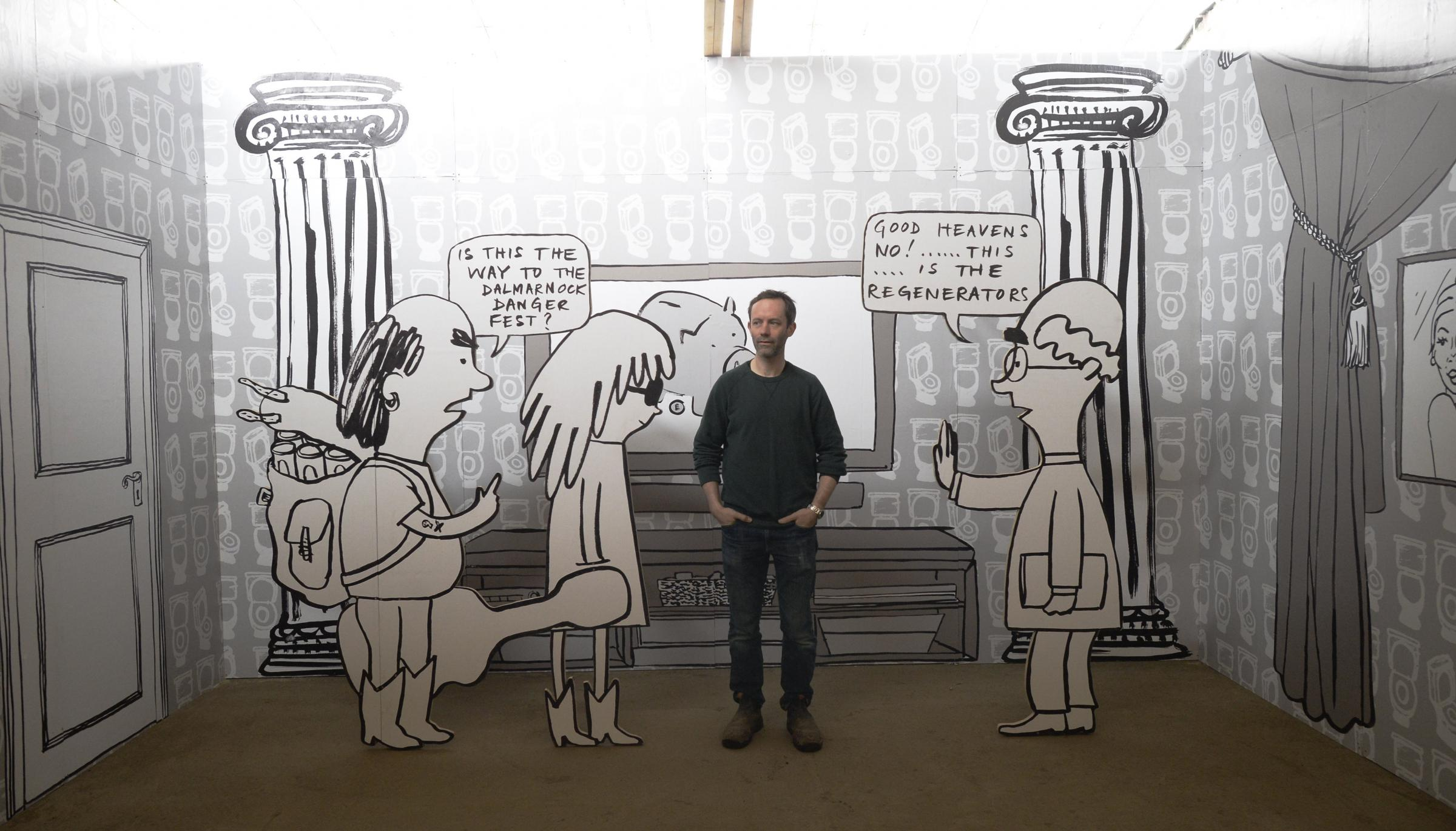 Artist Mick Peter poses for a photograph inside his massive billboard installation unveiled to open Glasgow International Festival of Visual Art.  Picture: Jamie Simpson