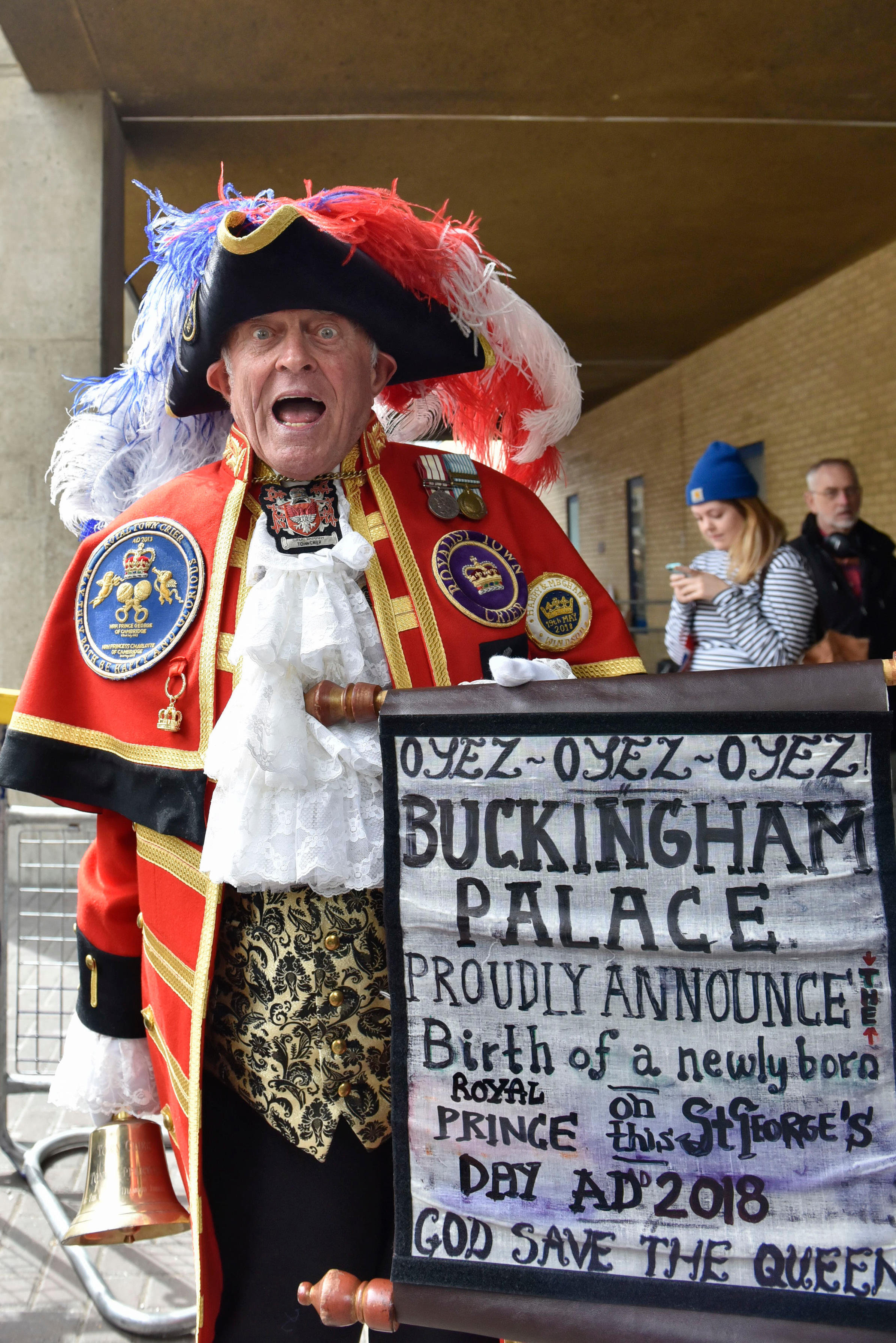 A man dressed as a town crier shouts outside the Lindo Wing of St Mary's Hospital after the birth of the new prince.