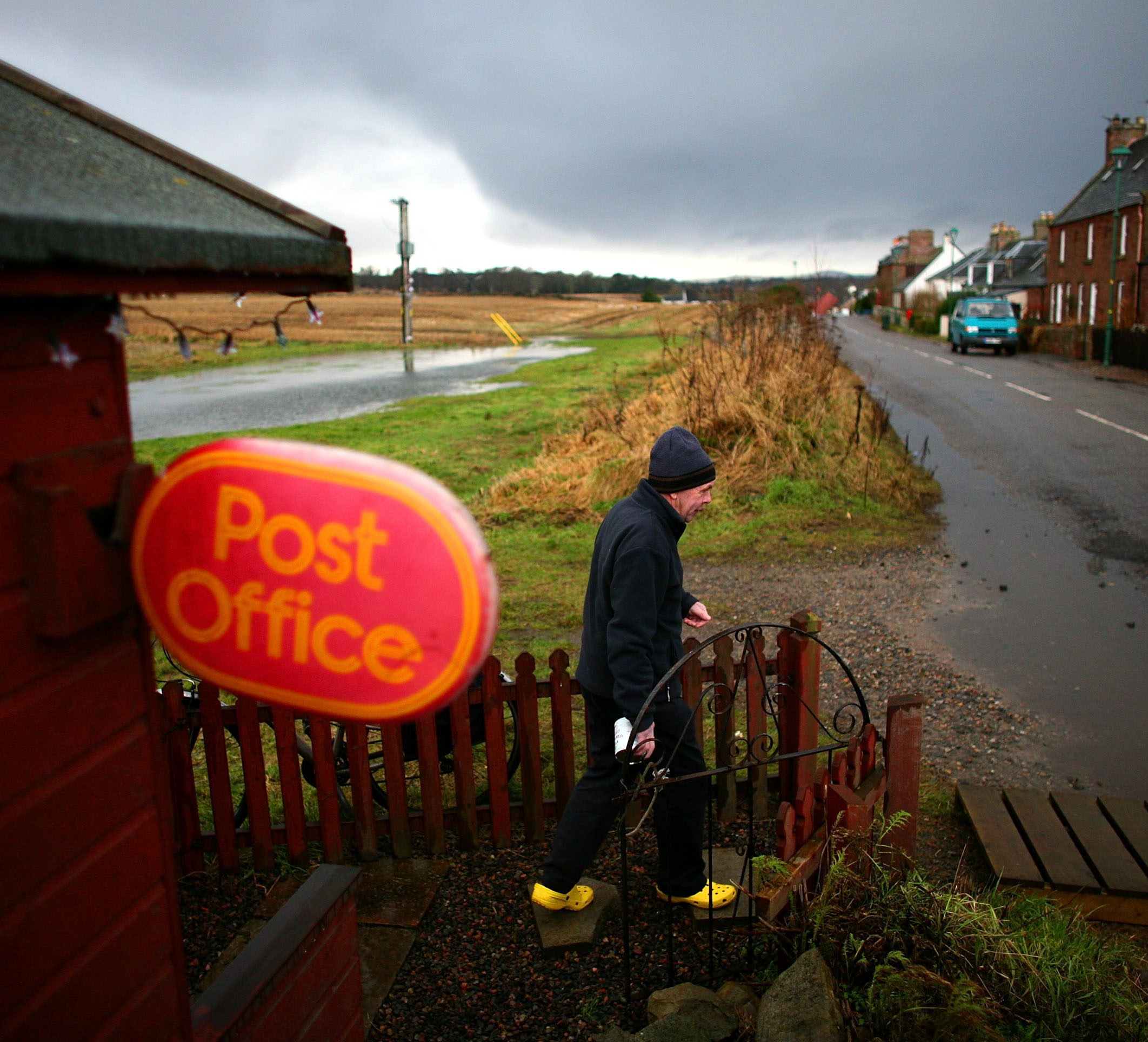 INVERNESS, UNITED KINGDOM - FEBRUARY 04: 2A customer walks out of Ponyntzfield Post Office, February 4, 2008 in Inverness, Scotland. The Post Office has proposed to close many rural branches across the country, causing anger amongst isolated communities w