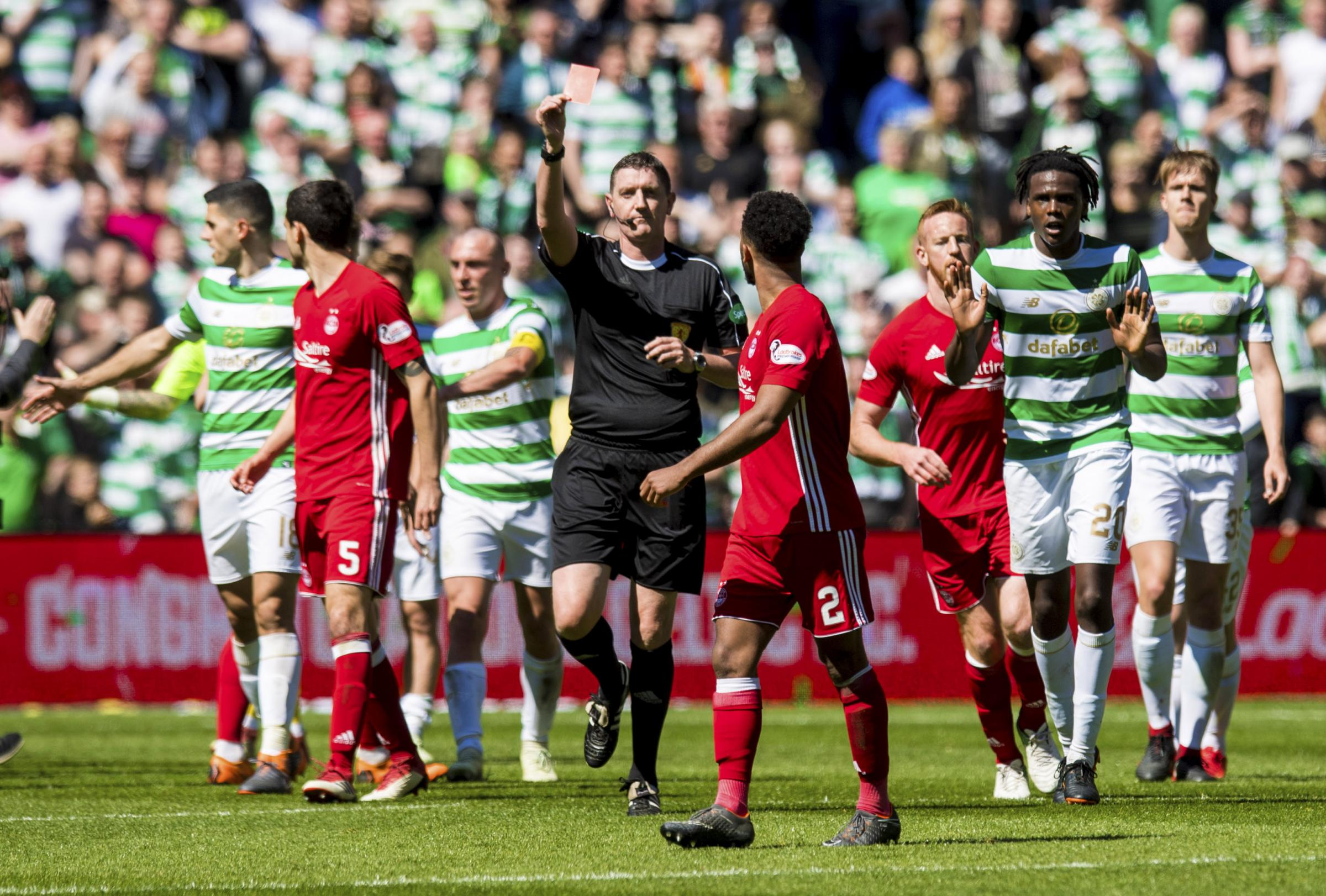 13/05/18 LADBROKES PREMIERSHIP. CELTIC v ABERDEEN. CELTIC PARK - GLASGOW . Aberdeen's Shay Logan exchanges words with the Celtic players as he is shown a red card by referee Craig Thomson.