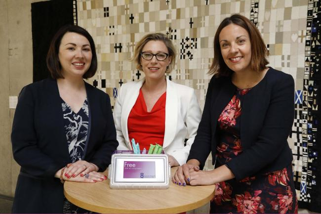 MSPs Monica Lennon, Gillian Martin and Kezia Dugdale, who have campaigned for free sanitary products, launch the new scheme at Holyrood