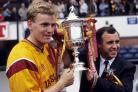 Steve Kirk lifts the Scottish Cup with Motherwell manager Tommy McLean in 1991.