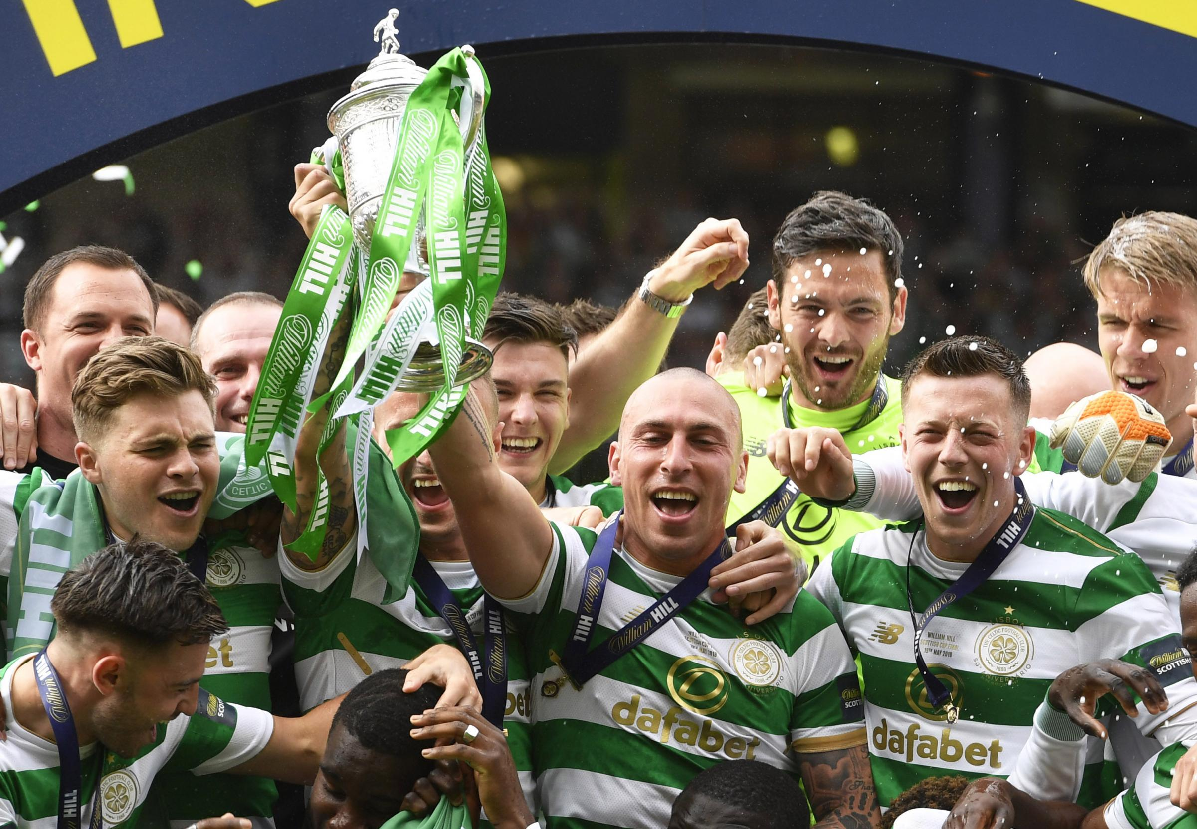 Celtic captain Scott Brown lifts the William Hill Scottish Cup trophy at Hampden.