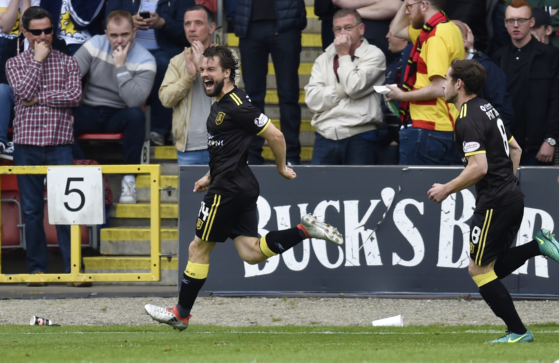 A jubilant Keaghan Jacobs wheels away after netting what proved to be the winner at Firhill (photo:  SNS Group)