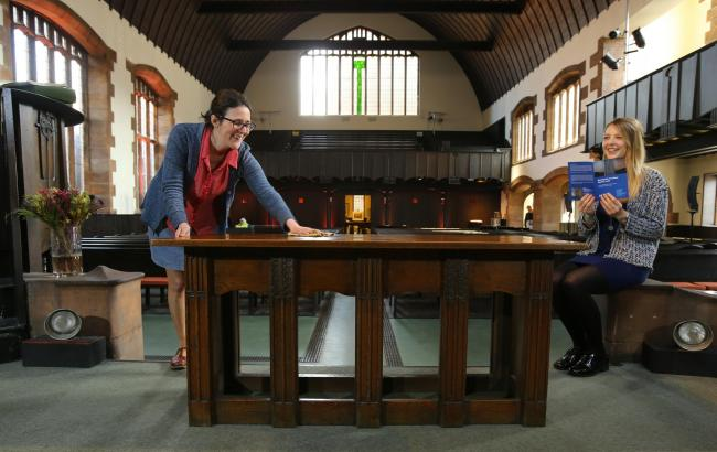 Alice McBride, left, and Jade Sturrock, of the Mackintosh Society, in Queen's Cross Church with a communion table designed by the artist. Pictures: Colin Mearns