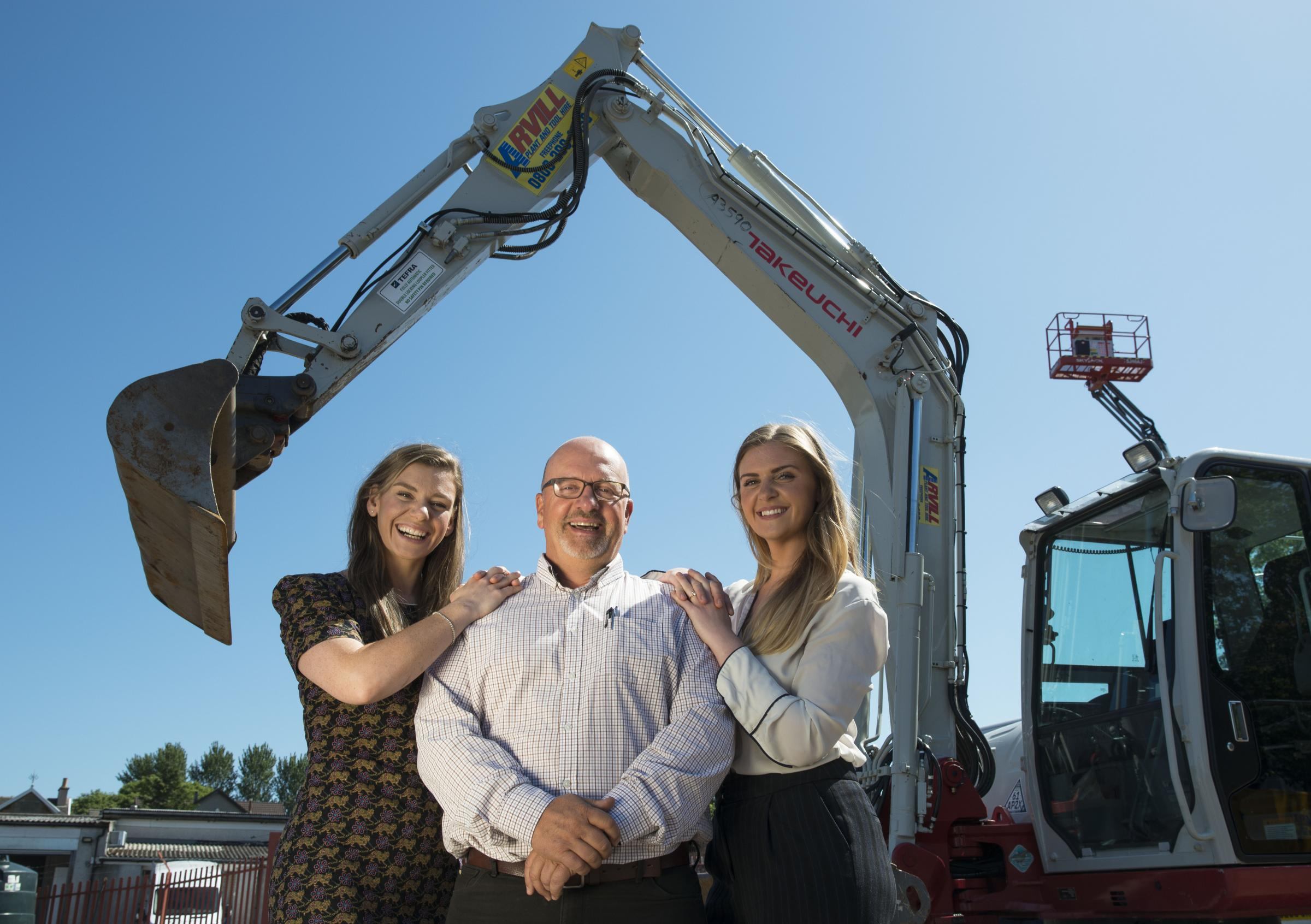 Hayley Shevill, right, pictured, with father Arthur and sister Amy at the site of their family's Arvill plant and tool hire business in Airdrie.