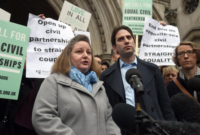 Rebecca Steinfeld and Charles Keidan outside the Royal Courts of Justice, London, after losing a previous round of their legal battle over civil partnerships.