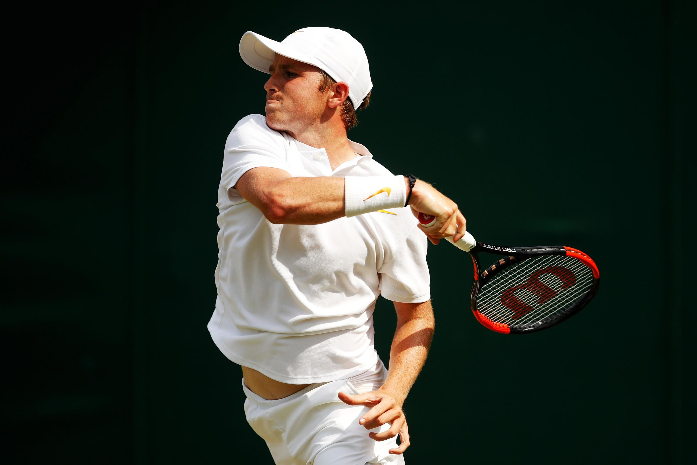 Aidan McHugh of Great Britain plays a forehand