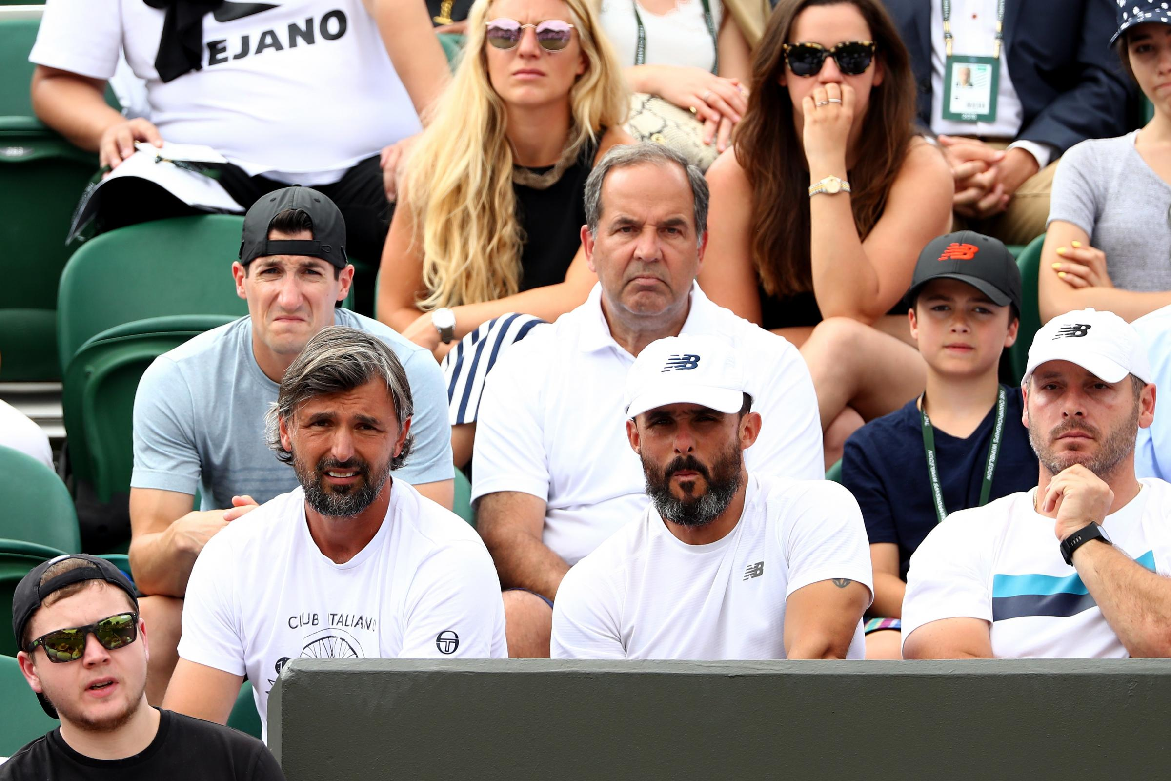 Goran Ivanisevic (bottom L), coach of Milos Raonic of Canada watches the action. Picture: Getty Images