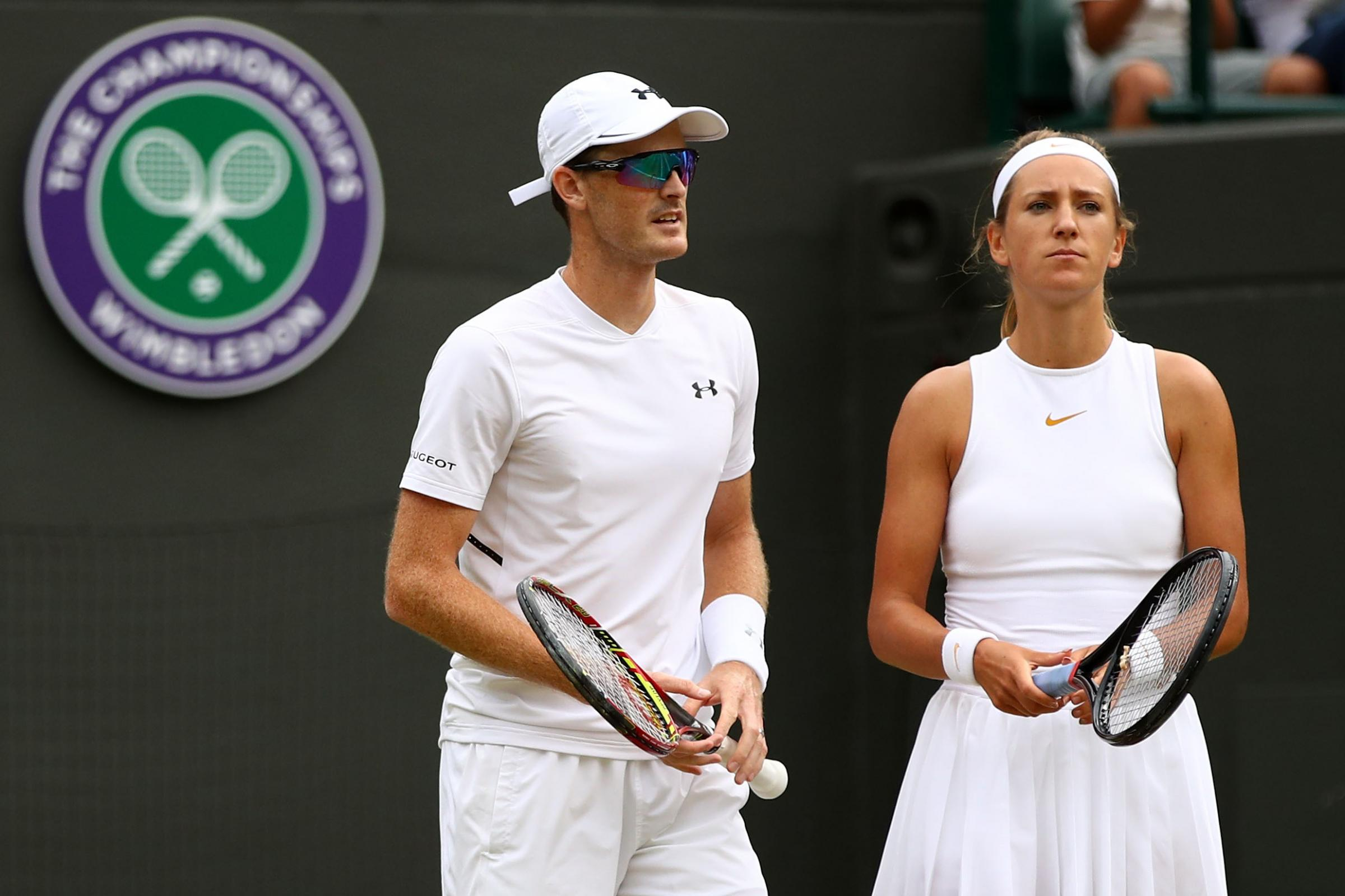 LONDON, ENGLAND - JULY 12:  Jamie Murray of Great Britain (L) and Victoria Azarenka of Belarus look on during their Mixed Doubles quarter-final match against Jean-Julien Rojer and Demi Schuurs of The Netherlands on day ten of the Wimbledon Lawn Tennis Cha