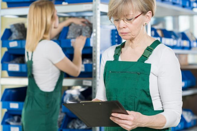 Stock image: older worker.Working women checking the warehouse in big factory.Release information: .Signed model release filed with Shutterstock, Inc.By: Photographee.eu.