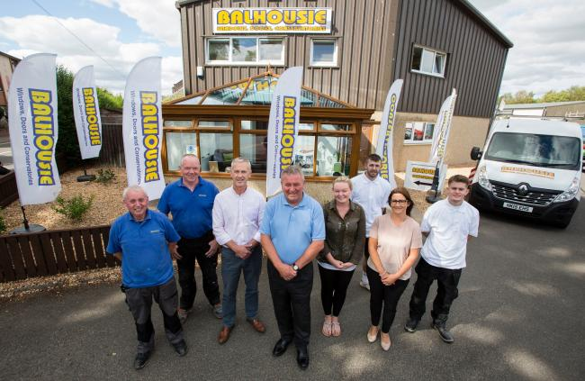 Drew Hay, left, and Malcolm Sweeney, right, with the team at Balhousie Glazing in Perth.