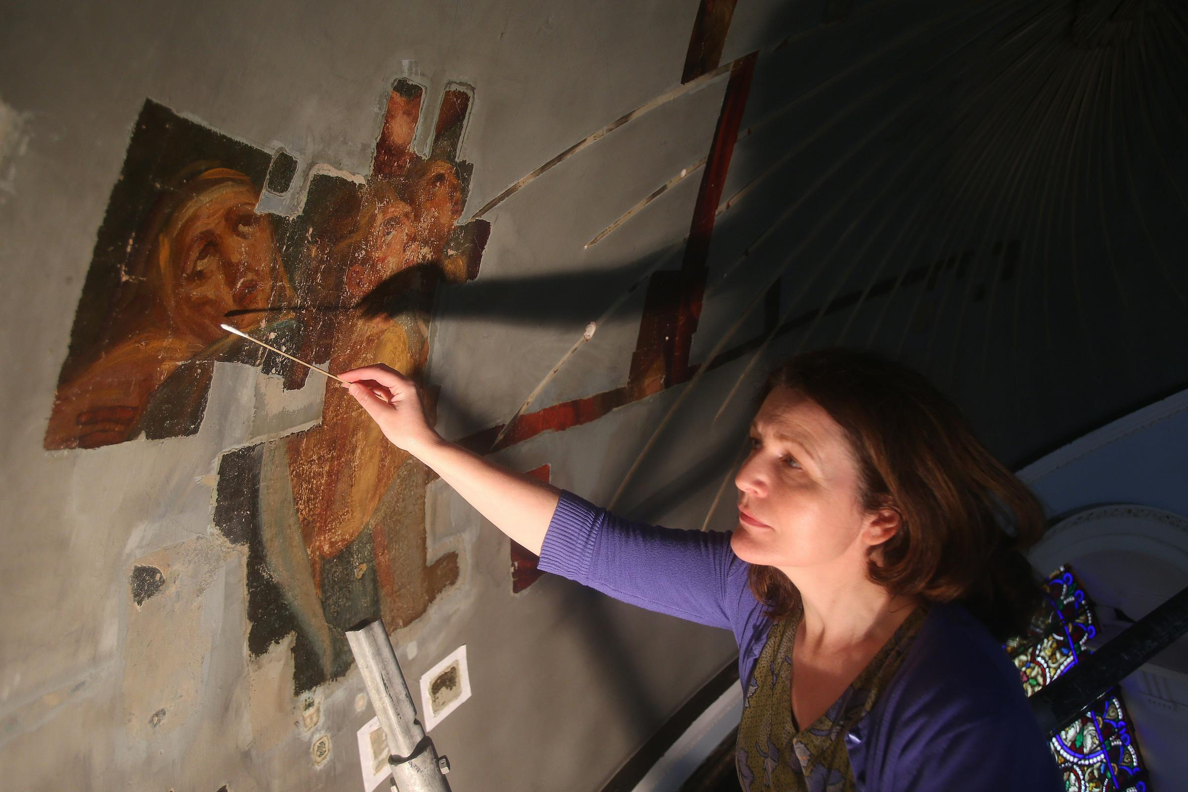 Art conservator Nicola Grimaldi of Northumbria University works on the Ascension of the Lord by Alexander Runciman at St Patrick's in Edinburgh. STY MILLERPicture: Gordon Terris/The Herald