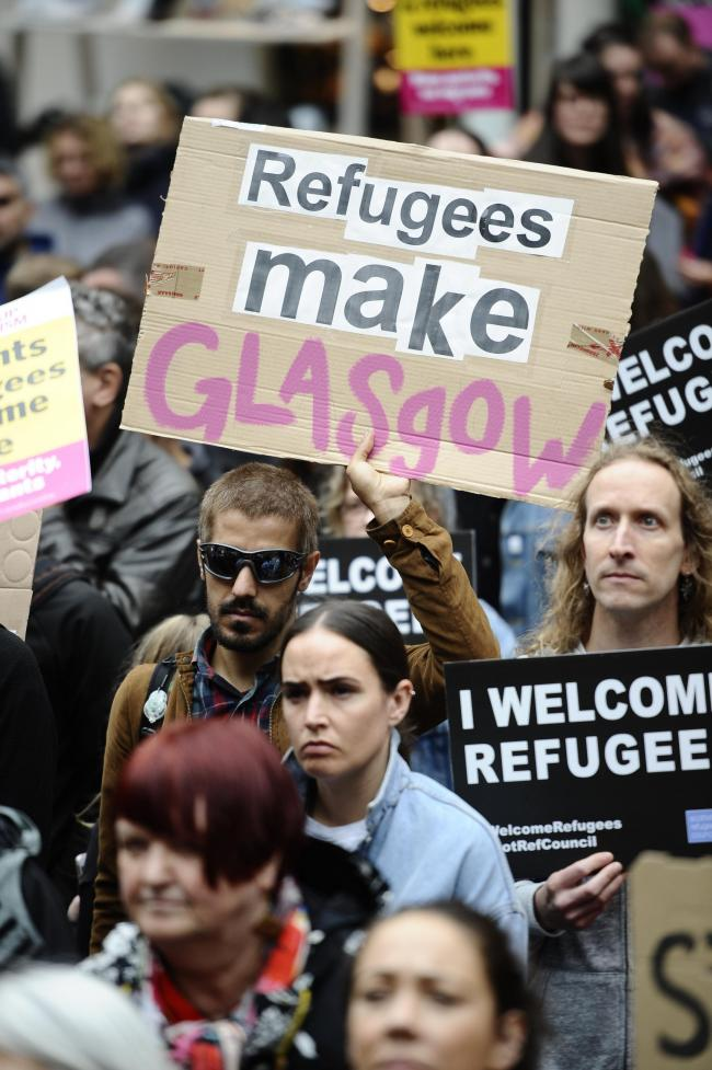 GLASGOW, SCOTLAND - JULY 31: protestors demonstrate in Glasgow City Centre against the decision by Serco to evict hundreds of asylum seekers from their homes on July 31, 2018 in Glasgow, Scotland. (Photo by Jamie Simpson/Herald & Times) - JS.