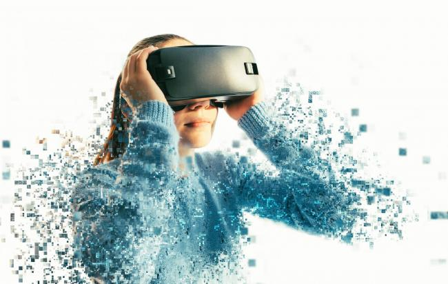 A person in virtual glasses flies to pixels. The woman with glasses of virtual reality. Future technology concept. Modern imaging technology. Fragmented by pixels.; Shutterstock ID 740252779; Purchase Order: 26/08/18; Job: news; Client/Licensee: sunday he