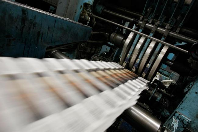 Shares in publisher Johnston Press fell by 18% yesterday after the firm admitted it may not be able to continue as a going concern in the next year.