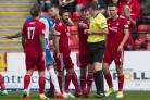 Aberdeen's Michael Devlin, left, is sent off by referee Craig Thomson against Kilmarnock.