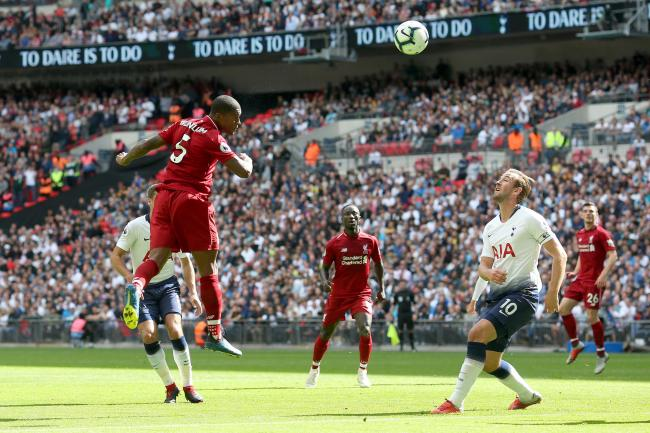 Georginio Wijnaldum of Liverpool scores their 1st goal during the Premier League match between Tottenham Hotspur and Liverpool FC at Wembley Stadium on September 15, 2018 in London, United Kingdom. (Photo by Charlotte Wilson/Offside/Getty Images)