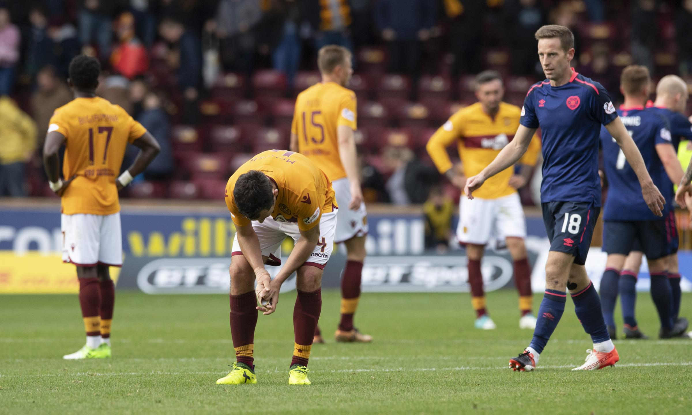 Carl McHugh is devastated at full-time after his mistake proved costly for Motherwell against Hearts.