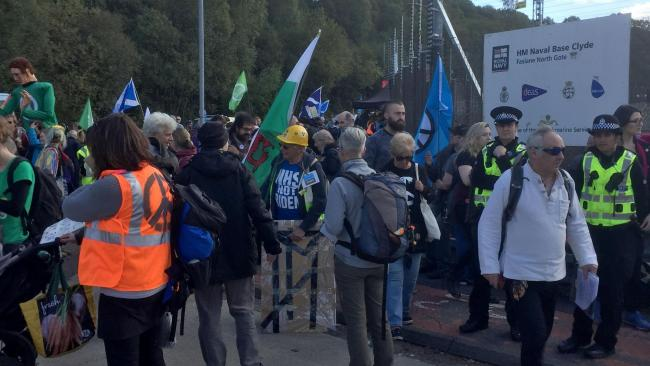 Peace campaigners gather at the gates of HMNB Clyde, the home of the UK's nuclear deterrent, for an international rally (Lucinda Cameron/PA)
