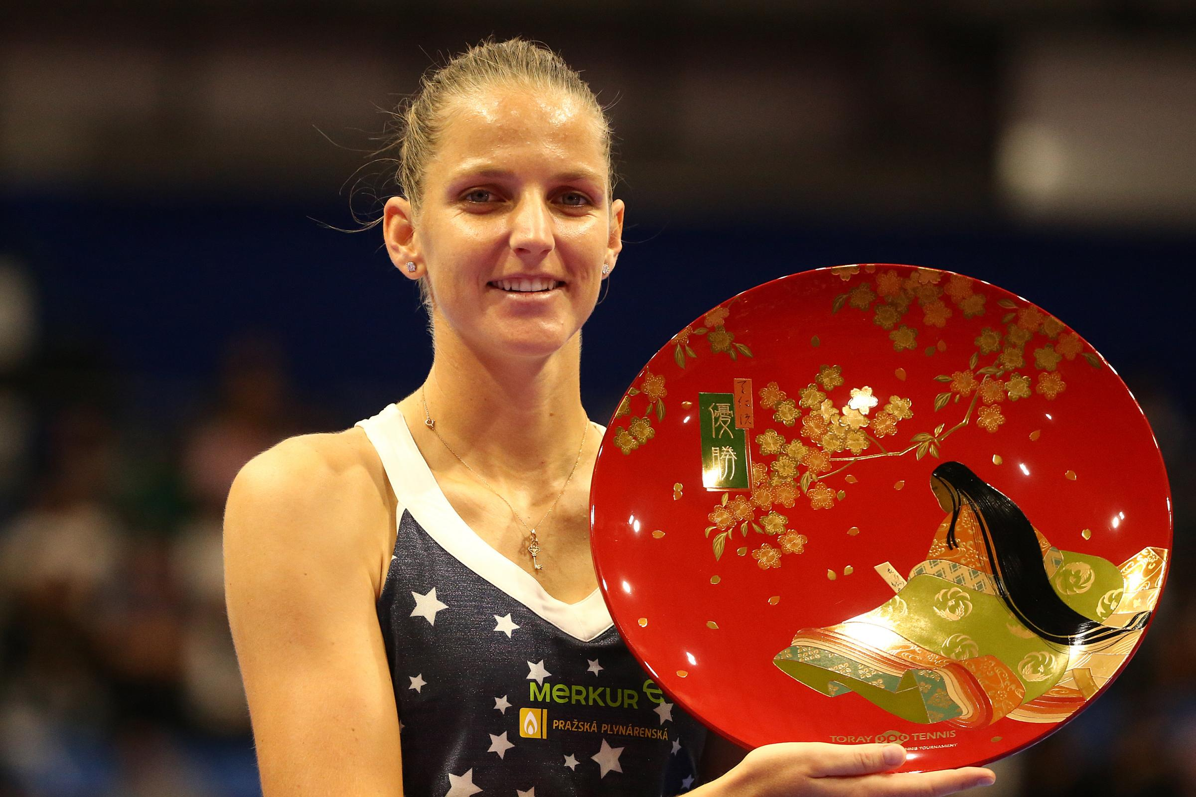 TACHIKAWA, JAPAN - SEPTEMBER 23: Singles champion Karolina Pliskova of the Czech Republic poses for photographs with the trophy after the Singles final against Naomi Osaka of Japan on day seven of the Toray Pan Pacific Open at Arena Tachikawa Tachihi on S