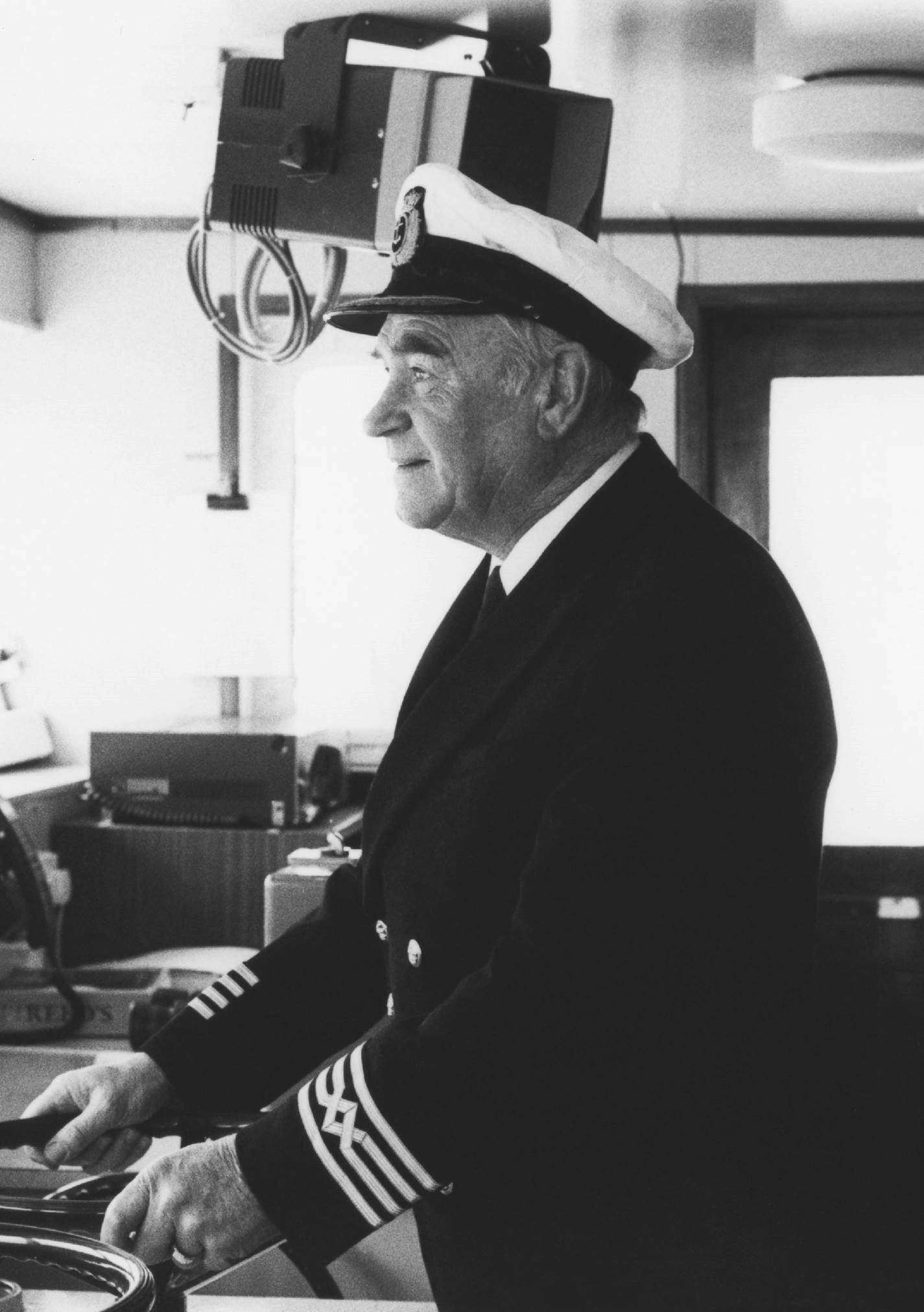Captain Robin L Hutchison 'Hurricane Hutch' on the bridge of MV Jupiter
