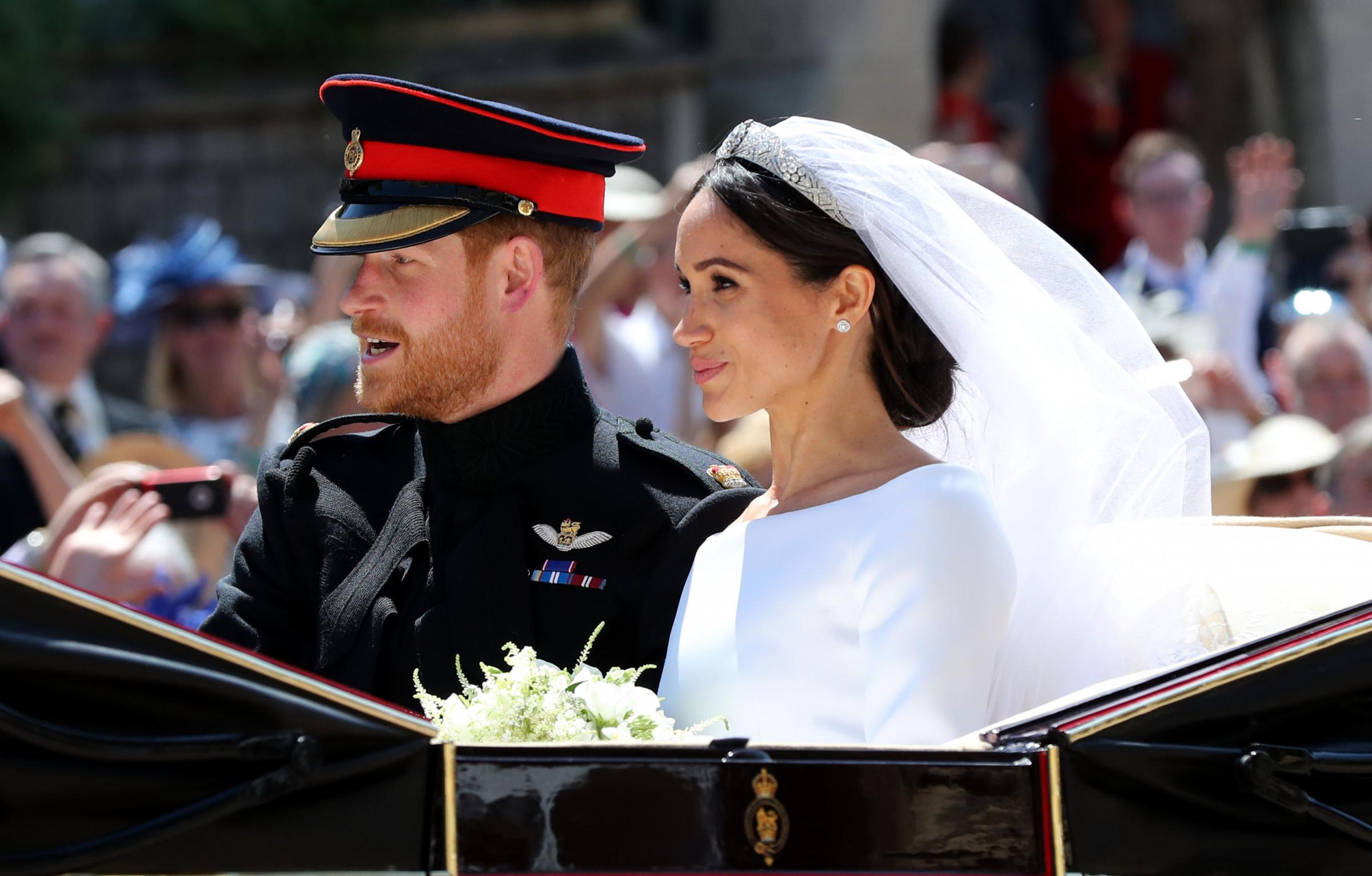 File photo dated 19/05/18 of Meghan Markle and Prince Harry leaving St George's Chapel at Windsor Castle after their wedding. During their wedding ceremony, Harry looked tenderly at his bride and smiled when the Dean of Windsor spoke o