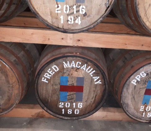 Isobel Frize spots this barrel quietly maturing at the Harris Distillery and says it is a good reason to keep in with comedian Fred MacAulay.