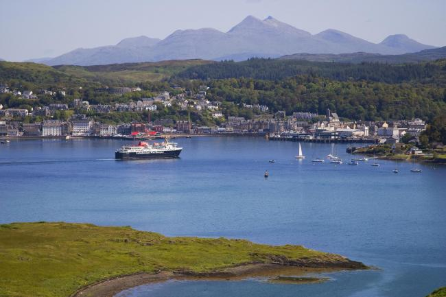 A ferry sails into beautiful Oban bay